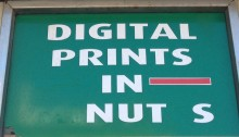 Shop sign advertising Digital Prints in Nuts