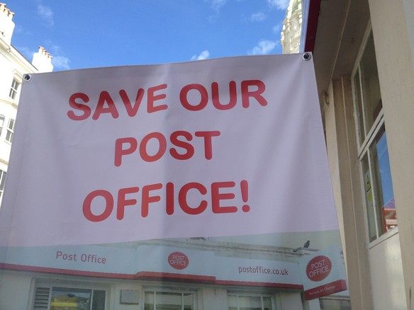 Banner outside a Post Office threatened with closure