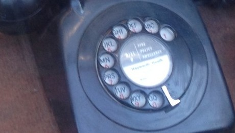 Black telephone with dial
