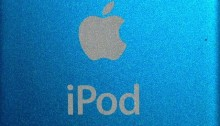Apple logo on the back of a blue iPod